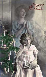 [Meditación de navidad con el ángel de la guarda. Fotografía en tarjeta postal de principios del siglo XX]